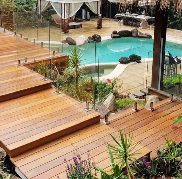 Luxury outdoor entertaining area with pool and staircase deck | Featured image for timber supplies Brisbane home page.