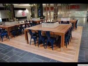 Wooden tables in a shopping centre.
